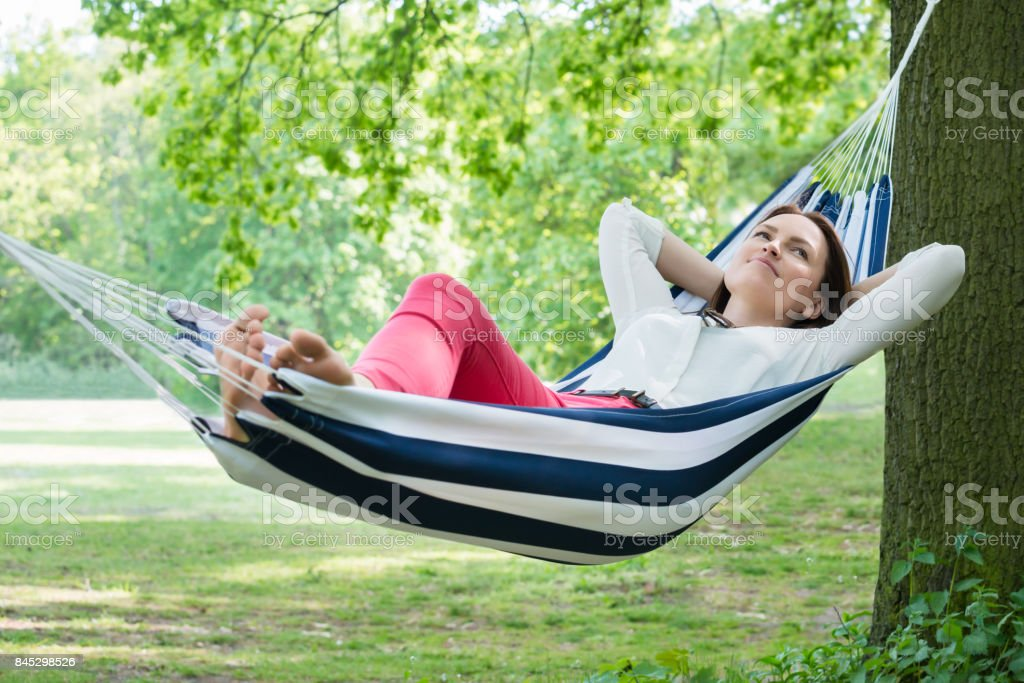Woman Relaxing In Hammock stock photo
