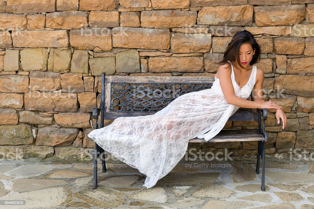 Woman relaxing in lace nightgown stock photo