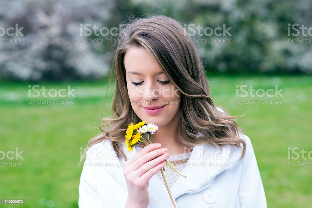 Woman relaxing in nature, alergy stock photo
