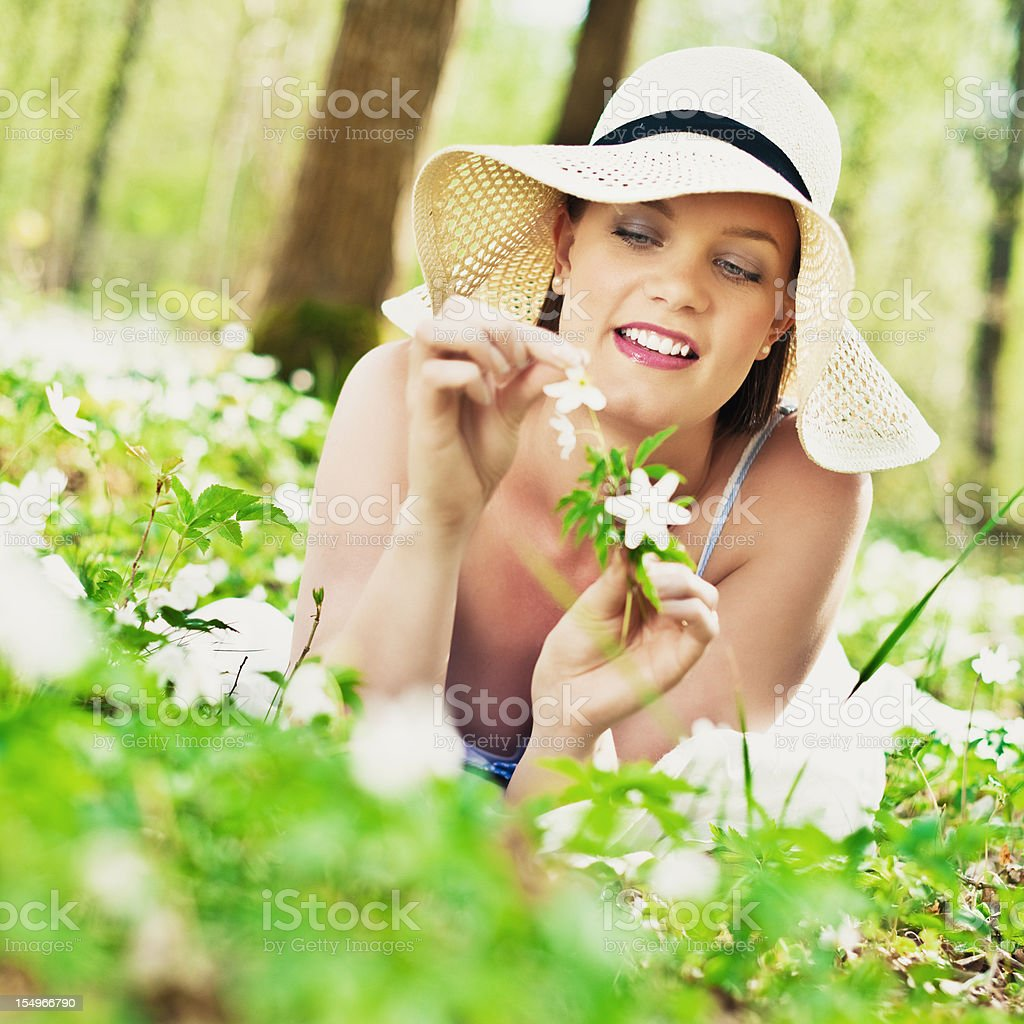 Woman relaxing in nature stock photo