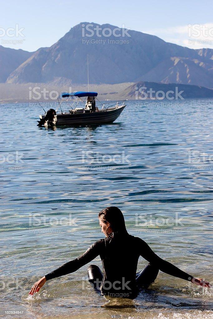 Woman Relaxing in Ocean stock photo