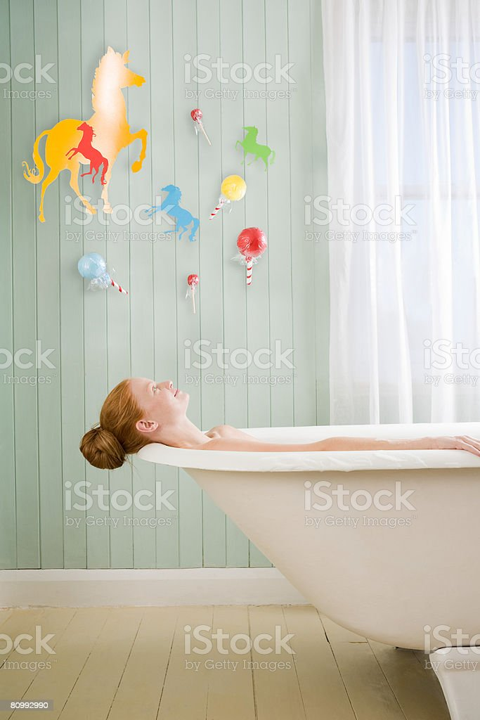 A woman relaxing in the bath royalty-free stock photo