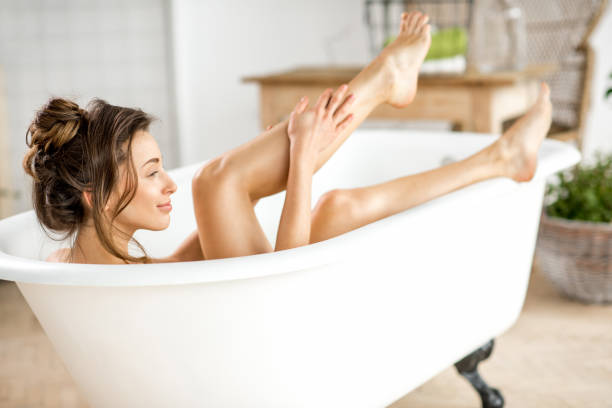 Woman relaxing in the bathtube ストックフォト