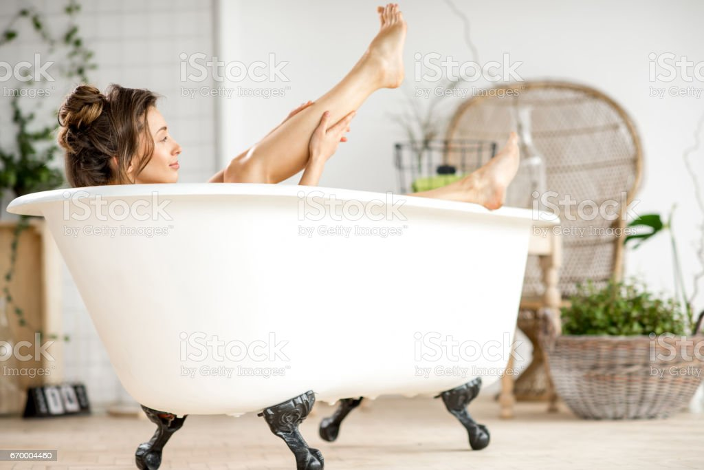Woman relaxing in the bathtube stock photo