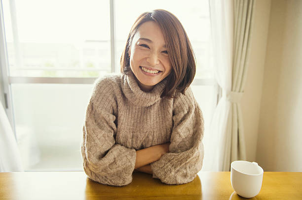 Woman relaxing in the living room ストックフォト