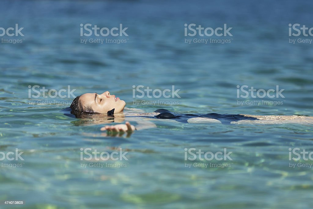 Woman relaxing in the sea royalty-free stock photo