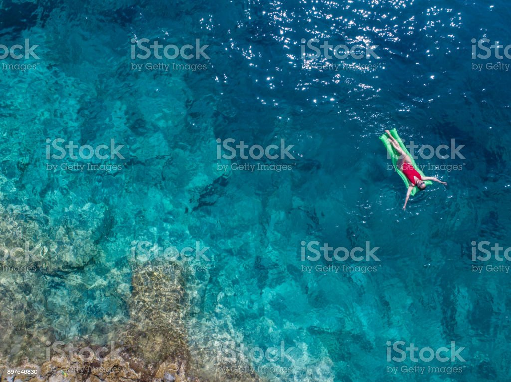 Woman relaxing in the sea stock photo