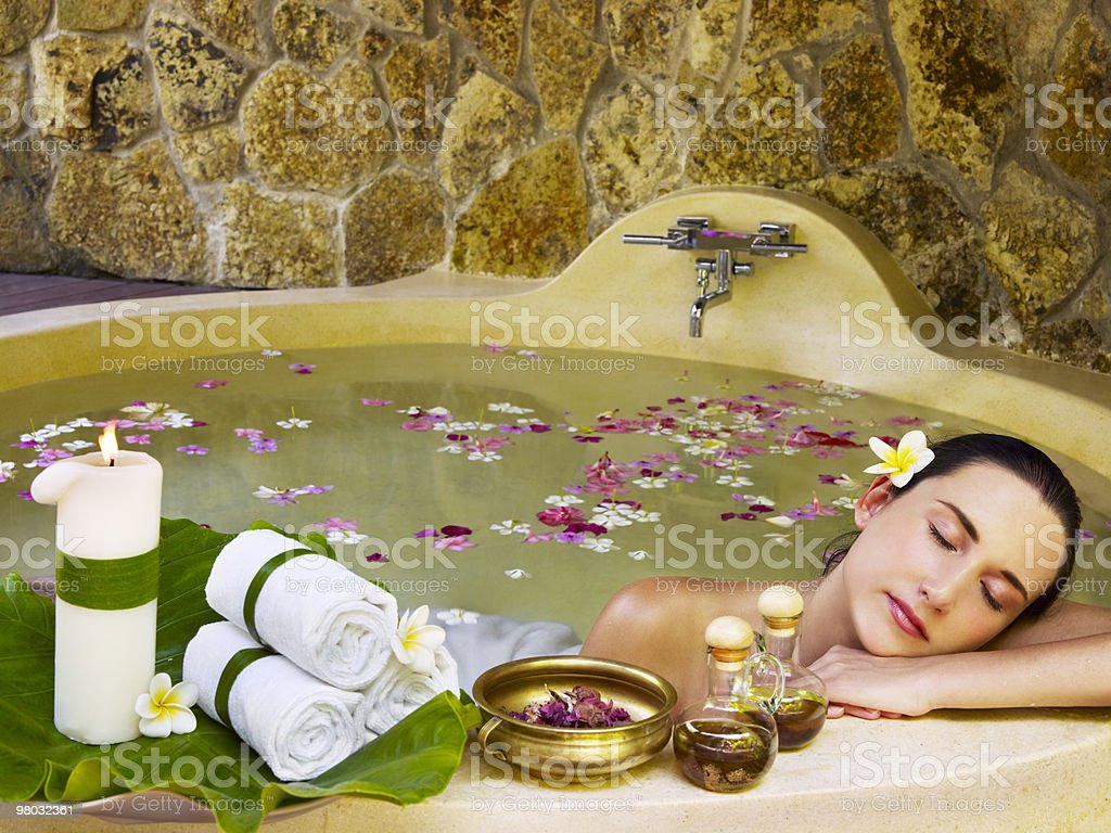A woman relaxing in the water at a spa center royalty-free stock photo
