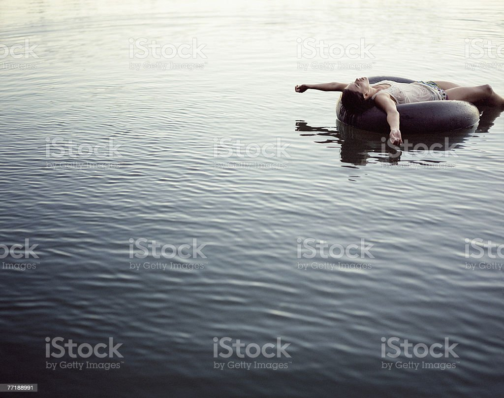 A woman relaxing in the water royalty-free stock photo