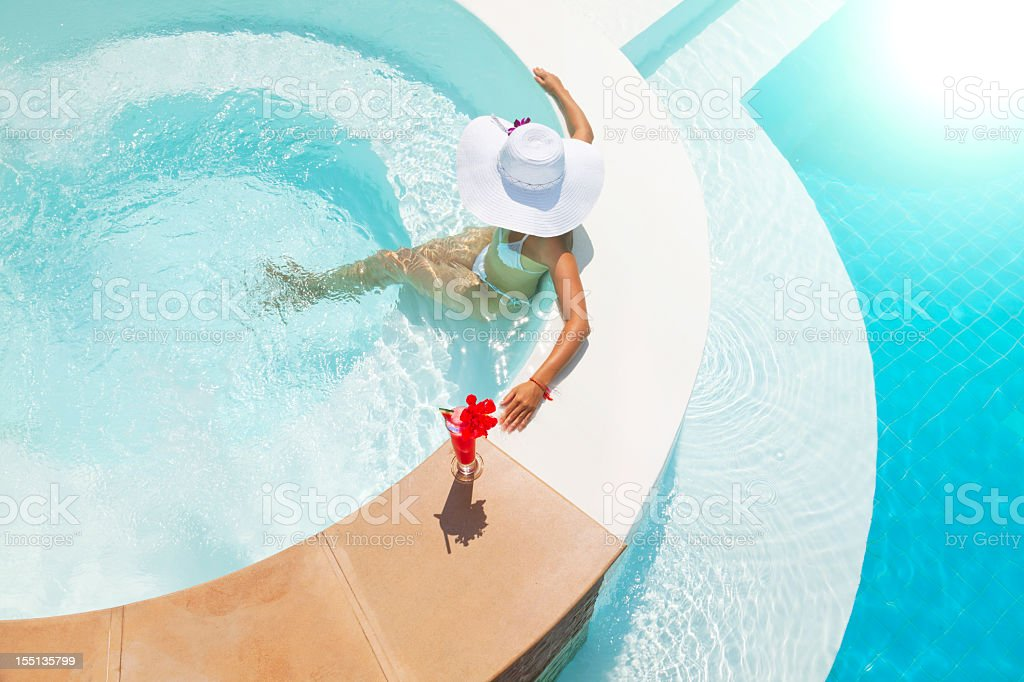 woman relaxing in waterpool royalty-free stock photo