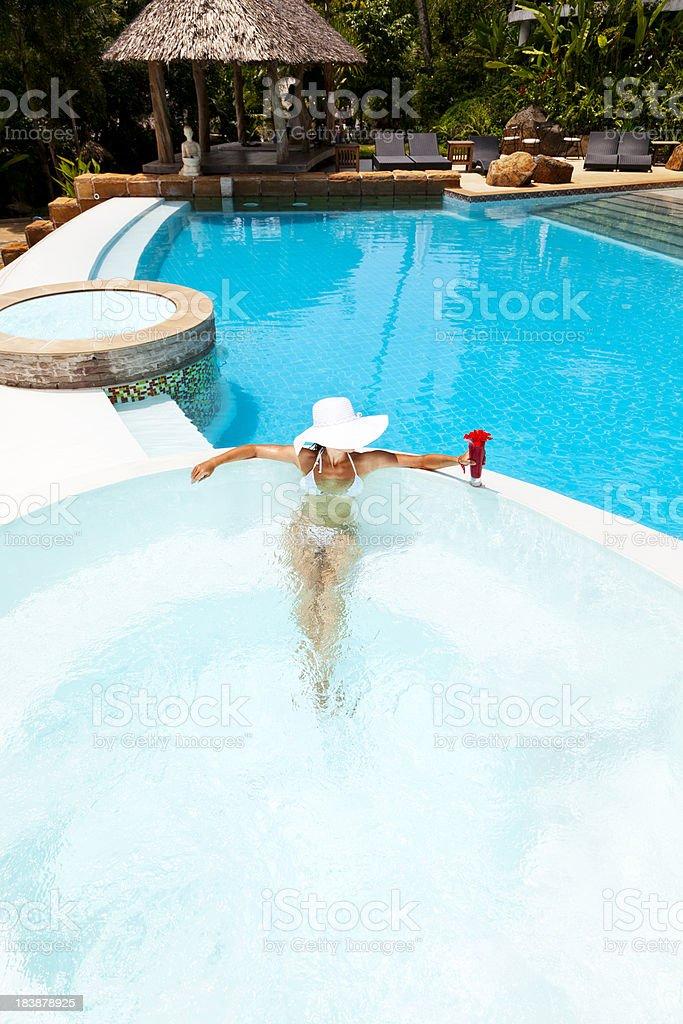 woman relaxing in waterpool stock photo