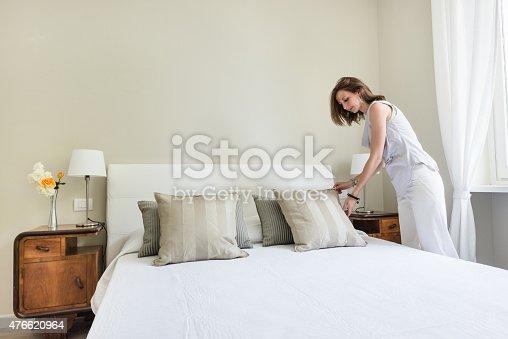 Woman relaxing inside her beautiful bedroom