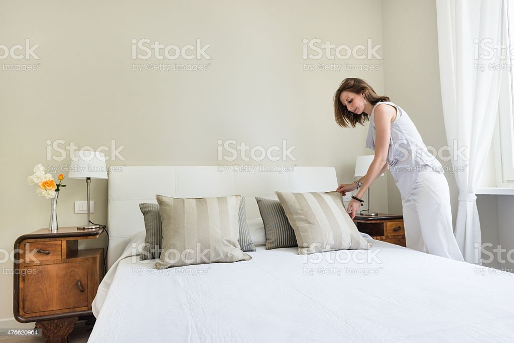 Woman relaxing inside her beautiful bedroom stock photo