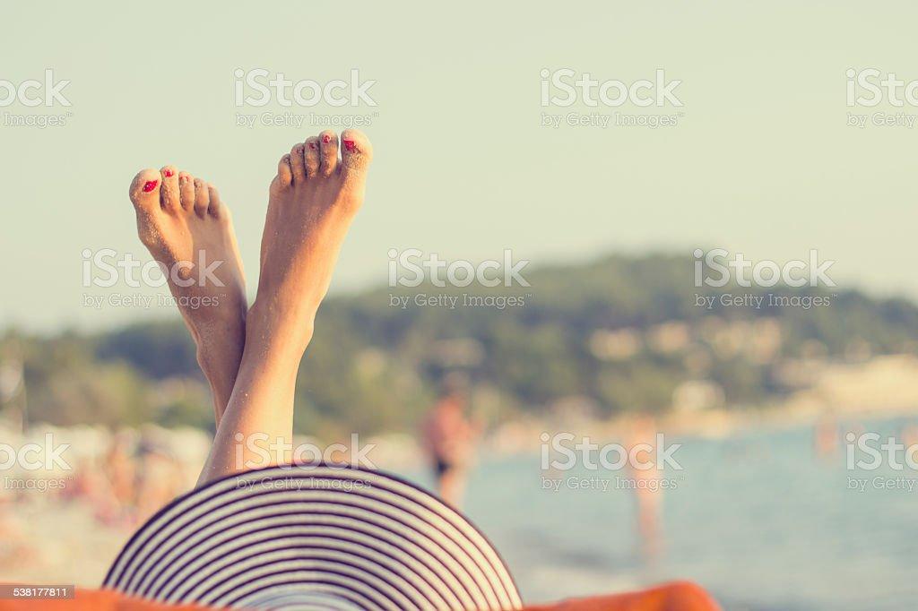 Woman Relaxing on a Beautiful Beach stock photo