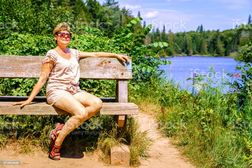 Woman relaxing on a bench royalty-free stock photo