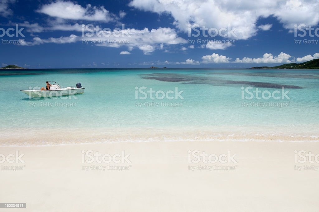 woman relaxing on a boat in the Caribbean royalty-free stock photo