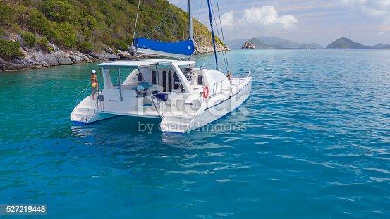 544966382istockphoto Woman relaxing on Catamaran in Caribbean 527219448