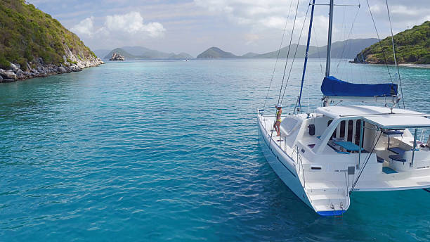 woman relaxing on catamaran in caribbean - katamaran bildbanksfoton och bilder