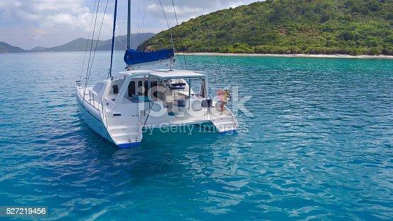 544966382istockphoto Woman relaxing on Catamaran in Caribbean 527219456