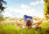 istock Woman relaxing on grass 850304464