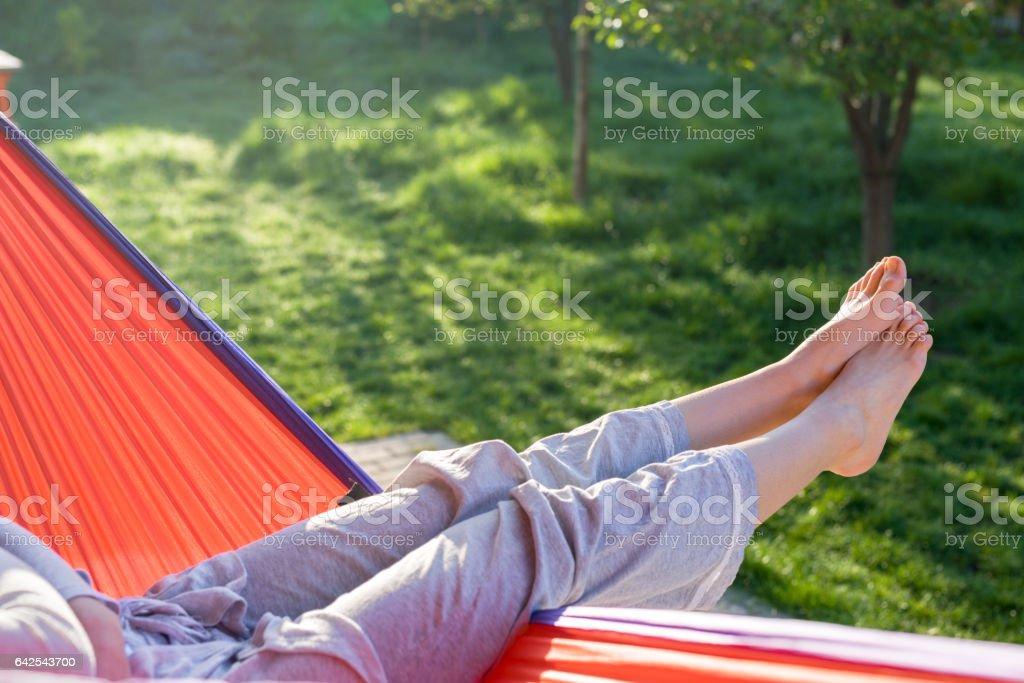 Woman relaxing on hammock outdoor – Foto