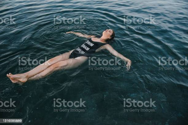 Photo of Woman relaxing on her back in a sea water