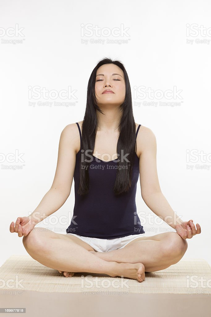 Woman relaxing on mat royalty-free stock photo