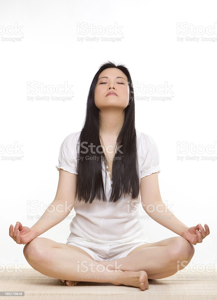 Woman relaxing on mat stock photo