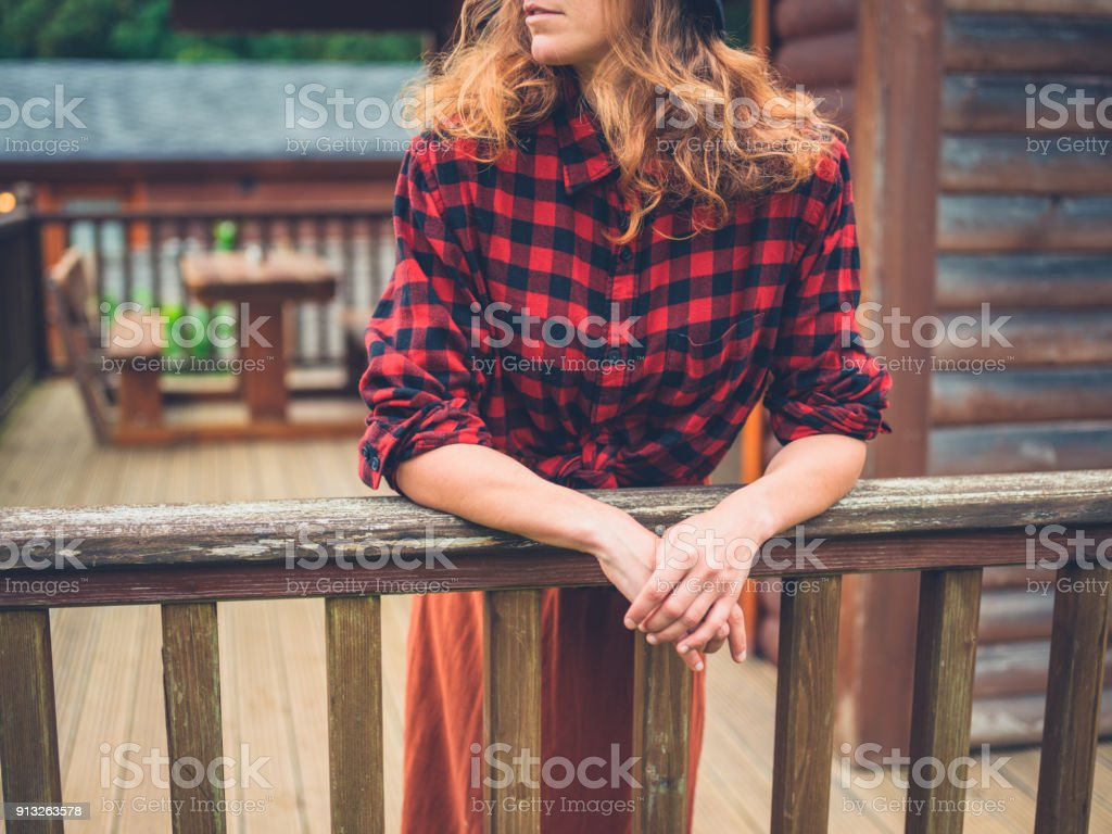 Woman relaxing on porch stock photo