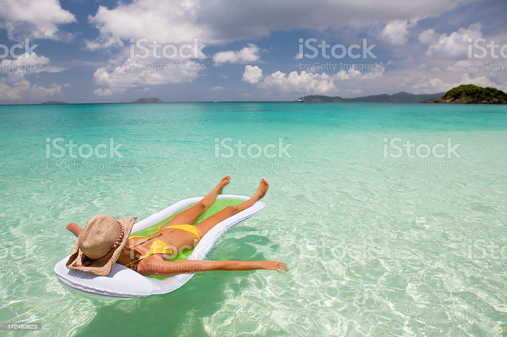 woman relaxing on raft at a tropical Caribbean beach royalty-free stock photo