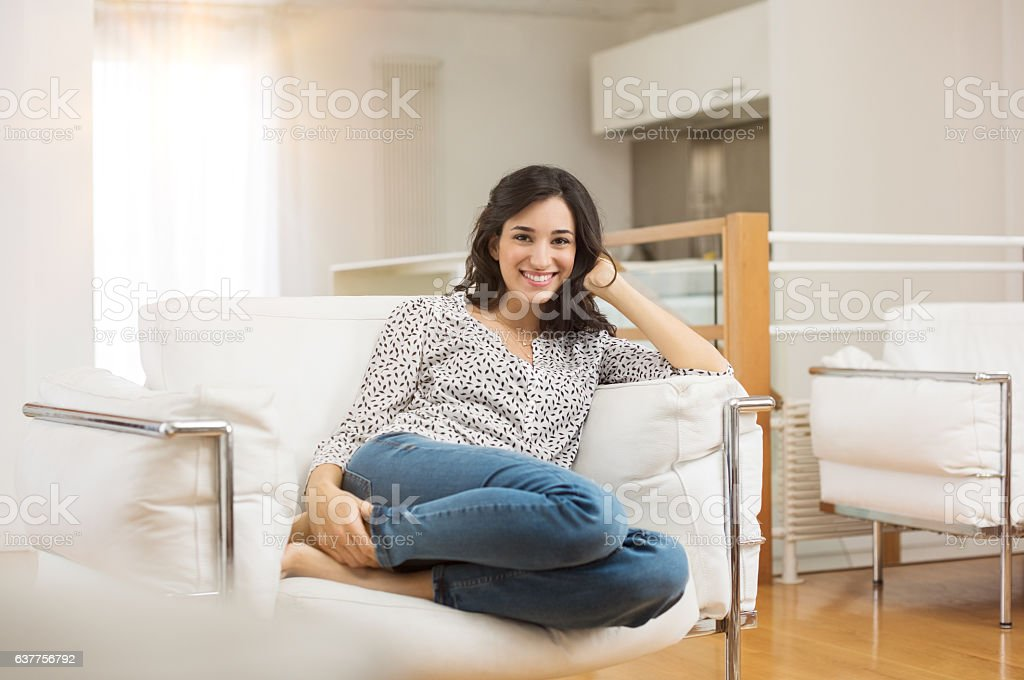 Woman relaxing on sofa stock photo