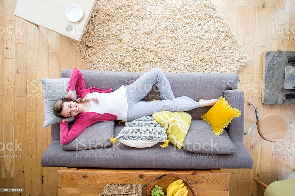 Woman Relaxing on Sofa stock photo