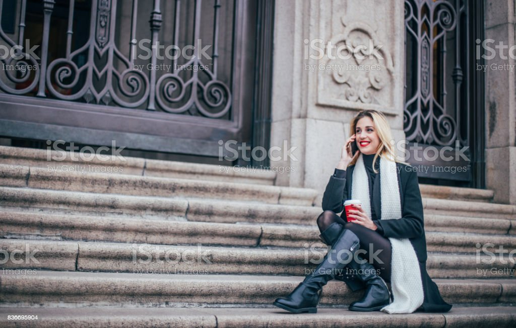 Woman relaxing on steps stock photo