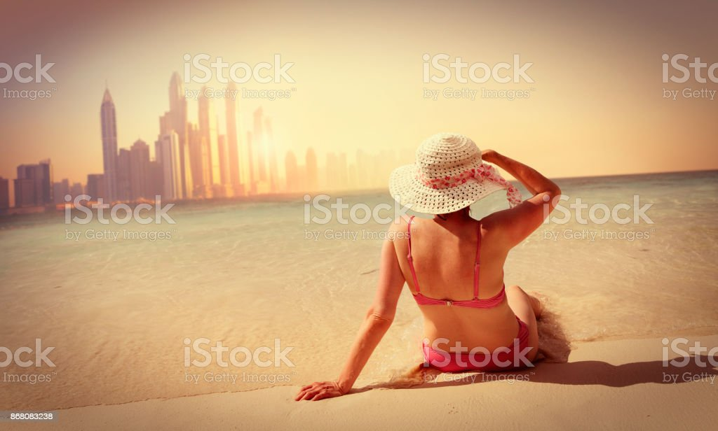 Woman relaxing on the beach in Dubai Mature woman relaxing on the beach in Dubai 40-49 Years Stock Photo