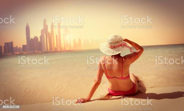 Woman Relaxing On The Beach In Dubai Stock Photo - Download Image Now