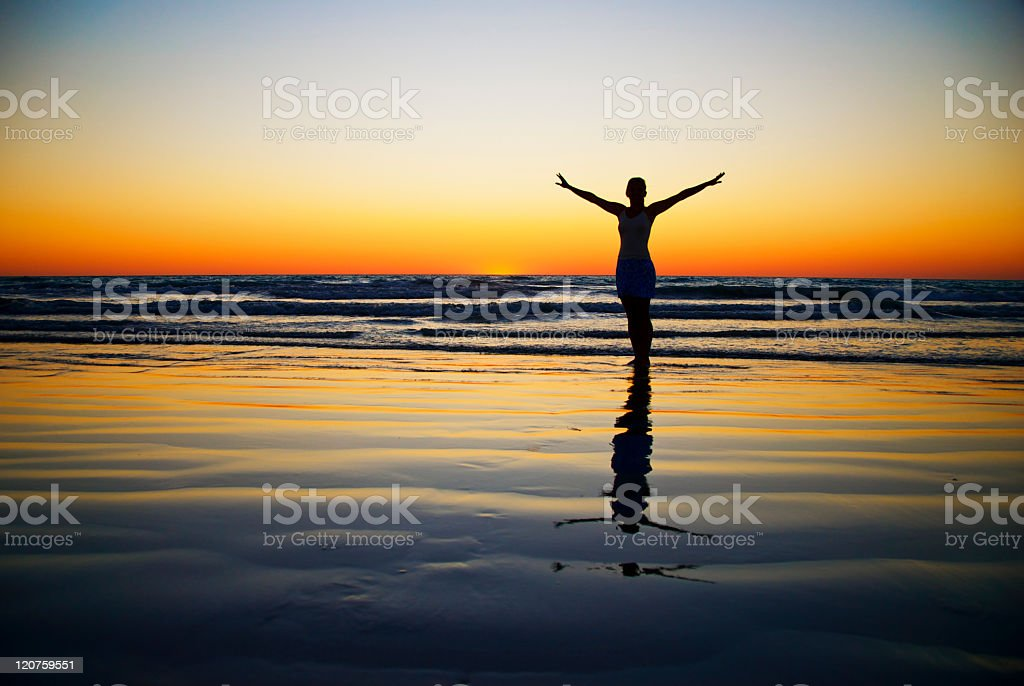 Woman Relaxing On The Beach stock photo