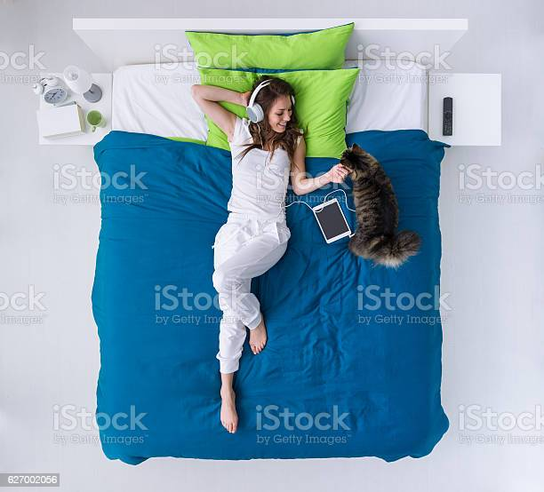 Woman relaxing on the bed picture id627002056?b=1&k=6&m=627002056&s=612x612&h=qqx nefy7vb6o55ccg1s9z xgnqmauzaumkwak0cgve=