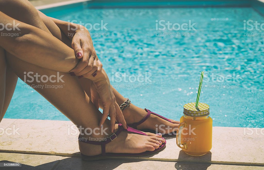 Woman relaxing on the pool. stock photo