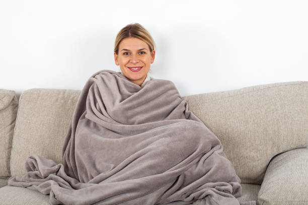 Woman relaxing on the sofa stock photo