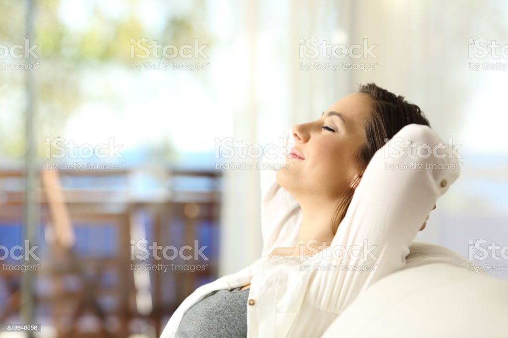 Woman relaxing on vacations in an apartment stock photo