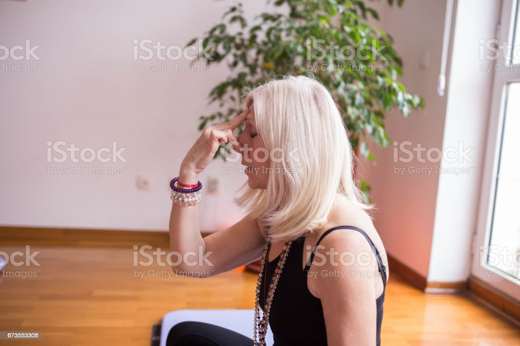 Woman relaxing on yoga class royalty-free stock photo