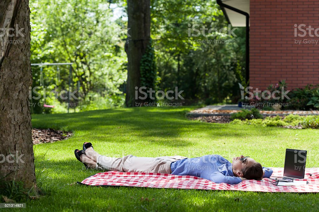 Woman relaxing outside after work stock photo