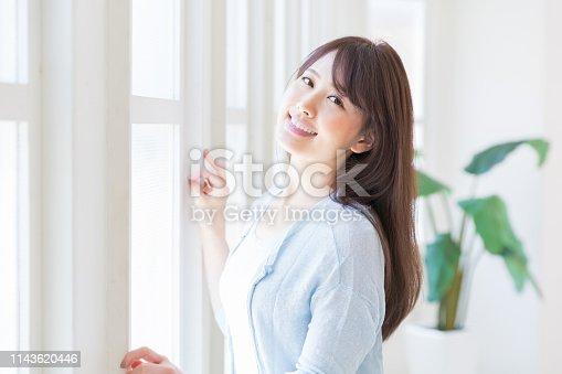 istock woman relaxing 1143620446