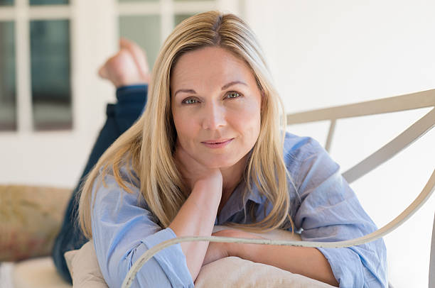 woman relaxing - mid adult women stock pictures, royalty-free photos & images