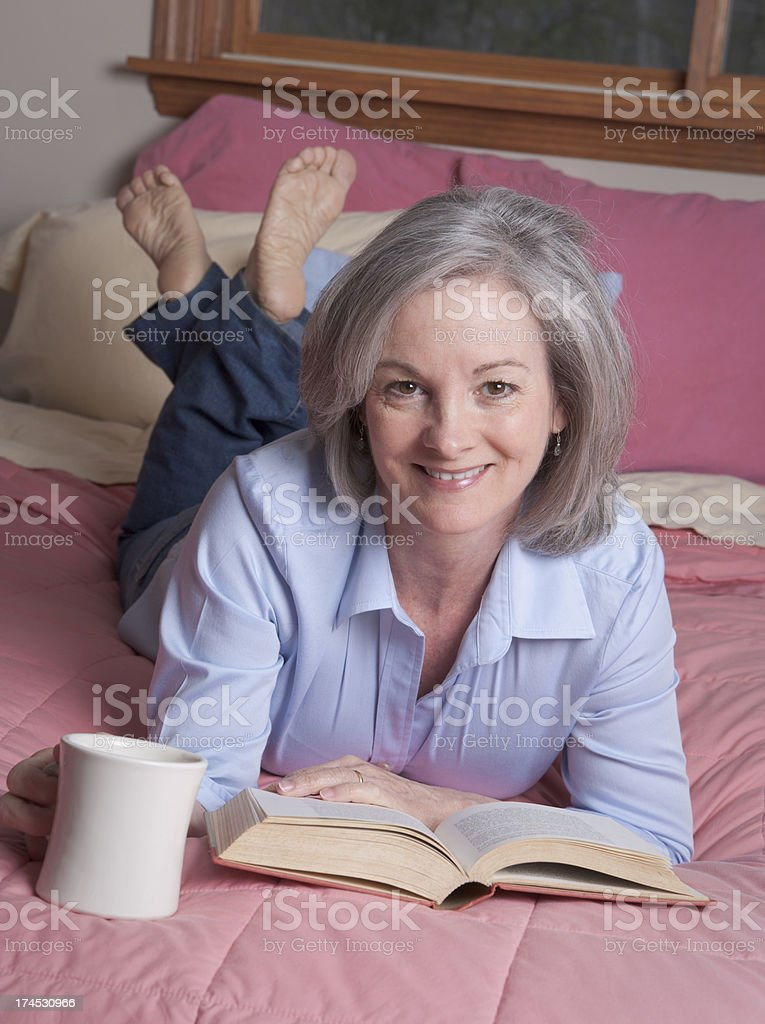 Woman relaxing with coffee and book royalty-free stock photo