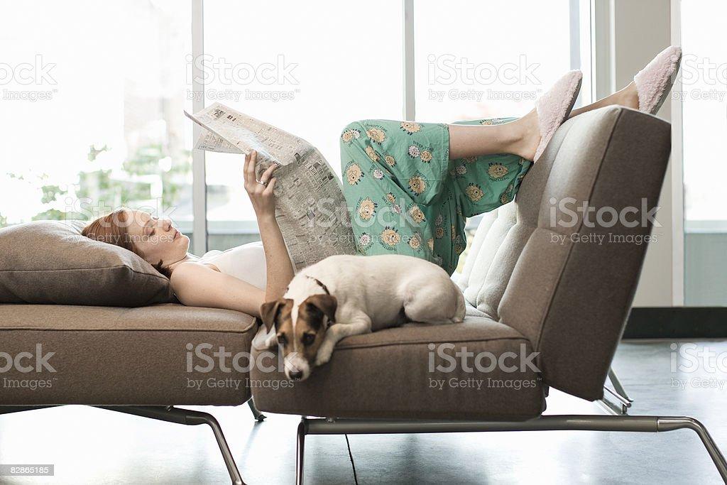 Woman Relaxing with Dog zbiór zdjęć royalty-free