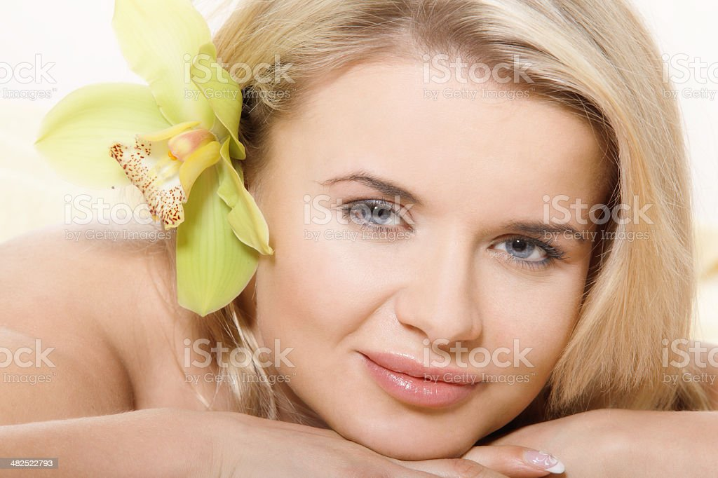 Woman relaxing with flower stock photo