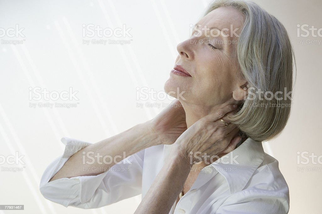 Woman relaxing with hands on neck stock photo