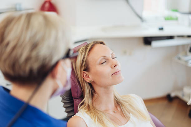 Woman relaxing with her eyes close at the dentist stock photo