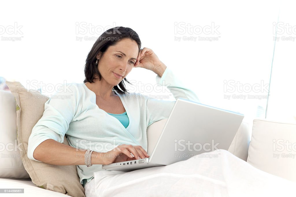 Woman relaxing with laptop stock photo